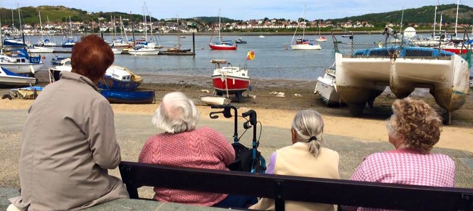 older people at the seaside in North Wales