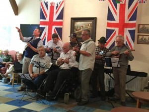 older people in a musical band on VE Day